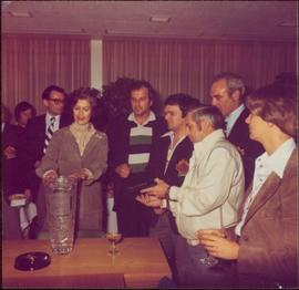 Iona Campagnolo admiring celebratory crystal vase after the International Ice Hockey Federation World Championships, 1978