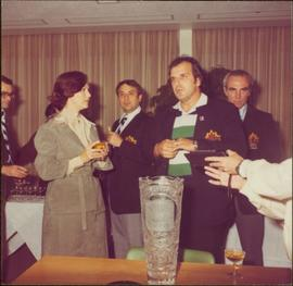 Iona Campagnolo speaks with several unidentified men wearing Team Canada jackets after the International Ice Hockey Federation World Championships, 1978