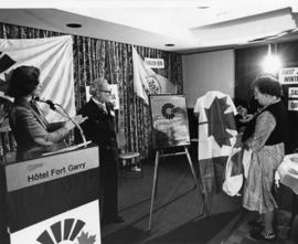 Iona Campagnolo and others looking at plaque at Canada Winter Games press conference in Hotel For...
