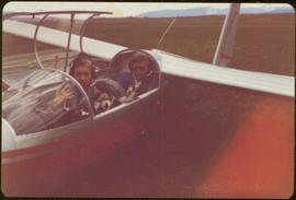 Skeena Riding tour - Iona Campagnolo and an unidentified man sitting in a glider