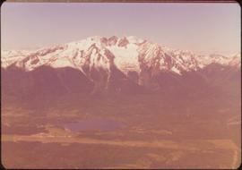 Skeena Riding tour - Aerial shot of lake with mountains in background