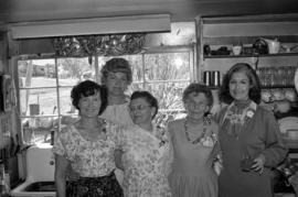 Iona Campagnolo with women at Bill Campbell's home in Smithers