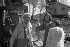Iona Campagnolo with Bill Campbell and women at his home in Smithers