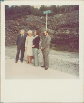 "Minister Iona Campagnolo standing with unidentified woman and two unidentified men in front of sign reading: ""Scott Rd"""