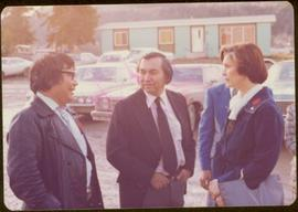 Walter Harris, Head Chief of Kispiox Village and Gitxsan artist; Union of British Columbia Indian Chiefs President George Manuel; and Iona Campagnolo stand talking outside in Kispiox, BC
