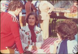 Commonwealth Games, Edmonton 1978 - Iona Campagnolo sits wearing a fringed white leather jacket w...