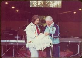 Commonwealth Games, Edmonton 1978 - Iona Campagnolo holds a white leather Canadian Commonwealth G...
