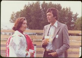 Commonwealth Games, Edmonton 1978 - Iona Campagnolo stands drinking with unidentified man