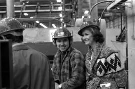 Iona Campagnolo and man with hard hat and ear protection at sawmill owned by Rim Forest Products ...