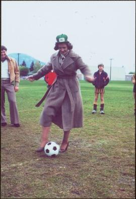 Iona Campagnolo performs the kickoff in heels and a DMJ Kickers hat at junior soccer tournament, ...