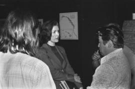 Iona Campagnolo talking to men at a road design meeting