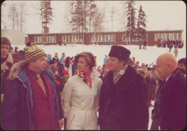 Stanley Ronald Basford, Iona Campagnolo, and Prime Minister Pierre Trudeau in front of an outdoor...