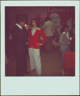 Iona Campagnolo stands, hands on her hips, in a room with Liberal posters on the walls after her ...