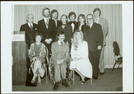 Group photo of Minister Iona Campagnolo, musician Leona Boyd, and nine unidentified others posing...