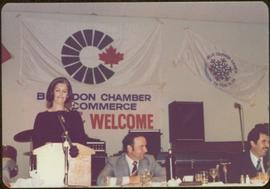 Canada Winter Games, Brandon, MB - Iona Campagnolo speaks at podium set on banquet table, two uni...