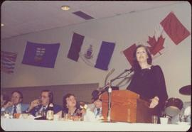 Canada Winter Games, Brandon, MB - Iona Campagnolo speaks at podium set on banquet table, unident...