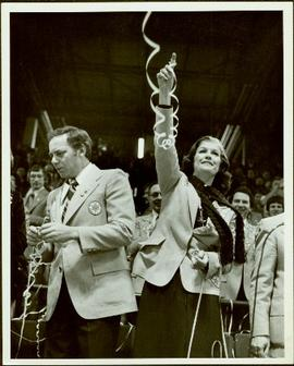 Canada Winter Games, Brandon, MB - Governor General Ed Schreyer and Iona Campagnolo raise ribbons at the closing of the games in crowded auditorium or arena