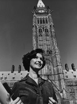 Iona Campagnolo standing in front of Peace Tower in Liberal publicity portrait