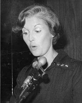 Iona Campagnolo speaking at microphone and wearing pin for 1980 Olympics in Liberal publicity image