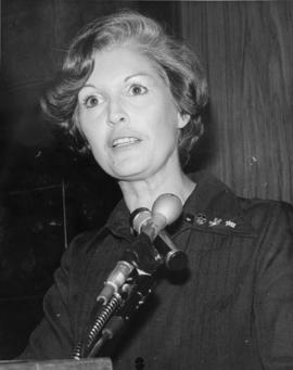 Iona Campagnolo speaking at microphone in Liberal publicity image