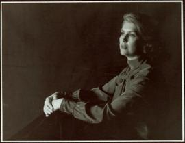 CBC Publicity Photos - Iona Campagnolo with hands folded on her knees, looking away from camera