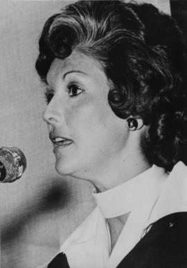 Iona Campagnolo at microphone in Liberal publicity image