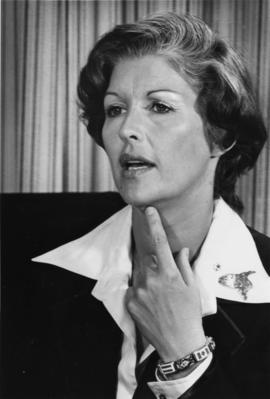 Iona Campagnolo wearing bracelet with Canadian and Austrian flags in Liberal publicity image for East Germany delegation