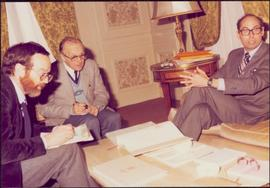 Paris Press Conference - Roger Jackson and two unidentified men sit around a coffee table consult...