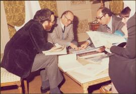 Paris Press Conference - Roger Jackson, Iona Campagnolo, and three unidentified others consult do...