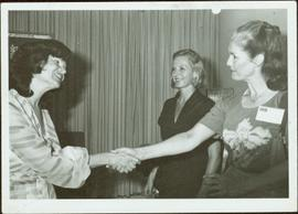 Iona Campagnolo shakes hands with Ofira Navon, wife of Israeli President Yitzhak Navon, while Pia Lindstrom looks on, Jerusalem, July 1980