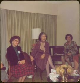 Iona Campagnolo sitting in living room with unidentified woman and Thérèse Casgrain, Quebecois feminist and former senator