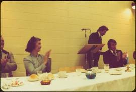 Iona Campagnolo clapping at head table as speaker steps away from the podium, Sportsman's Di...