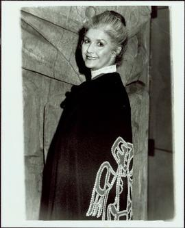 Iona Campagnolo wearing cape of Sahn-nag-x-wha in front of Ninstints totem pole in the Great Hall, Museum of Anthropology, University of British Columbia, Vancouver
