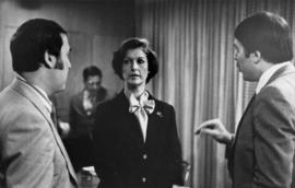 Iona Campagnolo speaking with unknown men