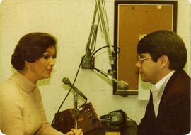 Iona Campagnolo at radio interview with unknown man
