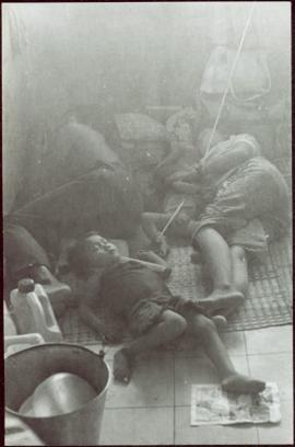 CUSO Mission, North-eastern Thailand - Unidentified family sleeps on a floor