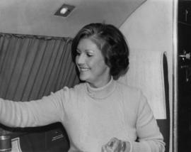 Iona Campagnolo seated in an airplane