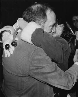 Prime Minister Pierre Trudeau hugging Iona Campagnolo dressed as Santa Claus