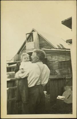 Man Holding Infant