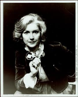 Campaign portrait of Iona Campagnolo holding a pair of glasses, October 1982