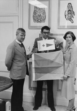 Iona Campagnolo with two men possibly holding coast guard ensign