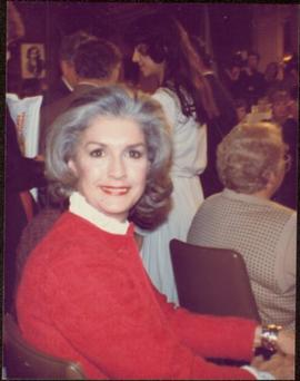 Close view of Iona Campagnolo sitting in a crowded hall during presidency campaign, November 1982