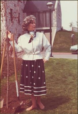 Iona Campagnolo, shoeless, planting a tree in Cambridge, Ontario, 1983