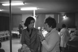 Iona Campagnolo speaking with woman, possibly at seniors centre