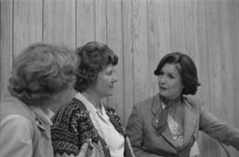 Iona Campagnolo speaking with women