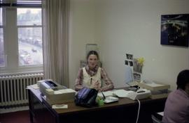 Woman behind desk in Iona Campagnolo's office