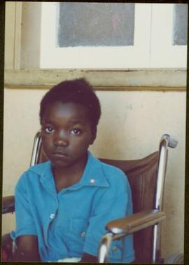 CUSO Mission in Angola - Unidentified child seated in a wheelchair