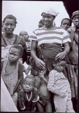CUSO Mission in Waku-Kungo, Angola - Group of unidentified women and children look at something o...