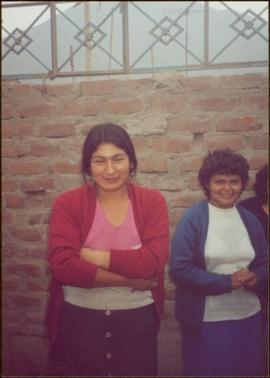 W.H.O. Trip, Ayacucho, Peru - Two unidentified women standing in front of brick wall