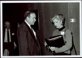 Frank King speaks with Iona Campagnolo at a 'Friends of Calgary '88' function, Faculty of Management, University of Calgary
